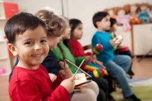 Preschool age children in music class